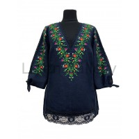 Yana, a blouse made of natural linen with embroidery and lace